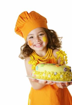 girl carrying cake