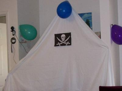 We hung sheets and Jolly Roger flags to make our living room like a pirate ship.